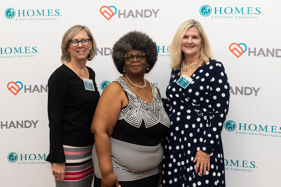 Pat Bessemer, H.O.M.E.S. Inc. Board Chair; Linda Taylor, H.O.M.E.S. Inc. CEO; and Wendy Wilson. Photo Courtesy of Downtown Photo.