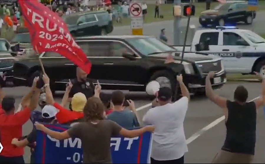 Trump supporters – some of whom question the outcome of the 2020 election – lined up on Route 100 angrily yelled insults, extended middle fingers, and waved flags emblazoned with pro-Trump and anti-Biden slogans – many of them containing obscenities – as the large motorcade passed by with a police escort.