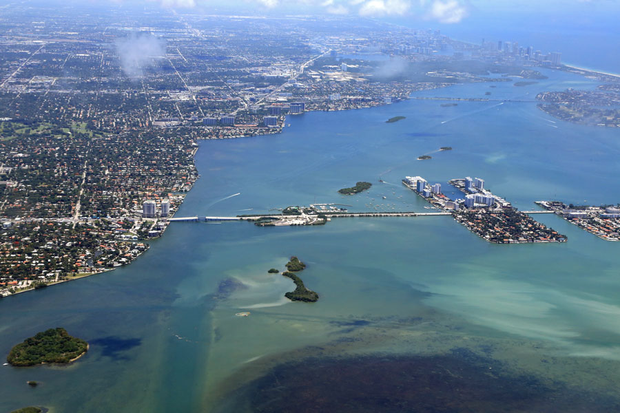 Aerial view of Venetian Causeway and Miami, with Biscayne Bay, and shallow waters. North Bay Village seen to the right. File photo: ShutterStock.com, licensed.