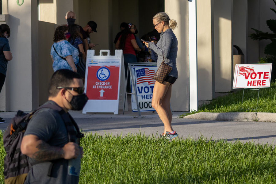 People waiting in line to vote at city hall in Cooper City, Florida on November 3, 2020