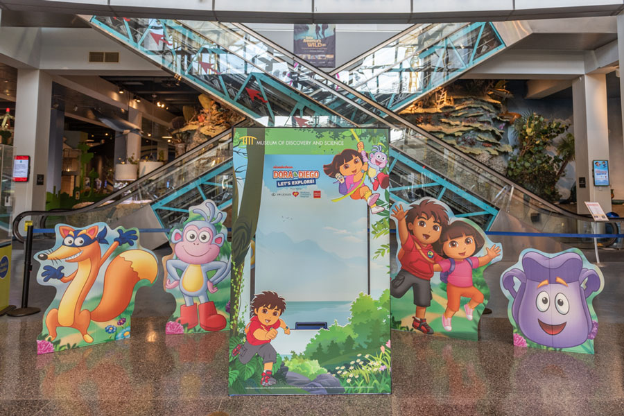Dora & Diego – Let's Explore! photo box and display at the Museum entrance.
