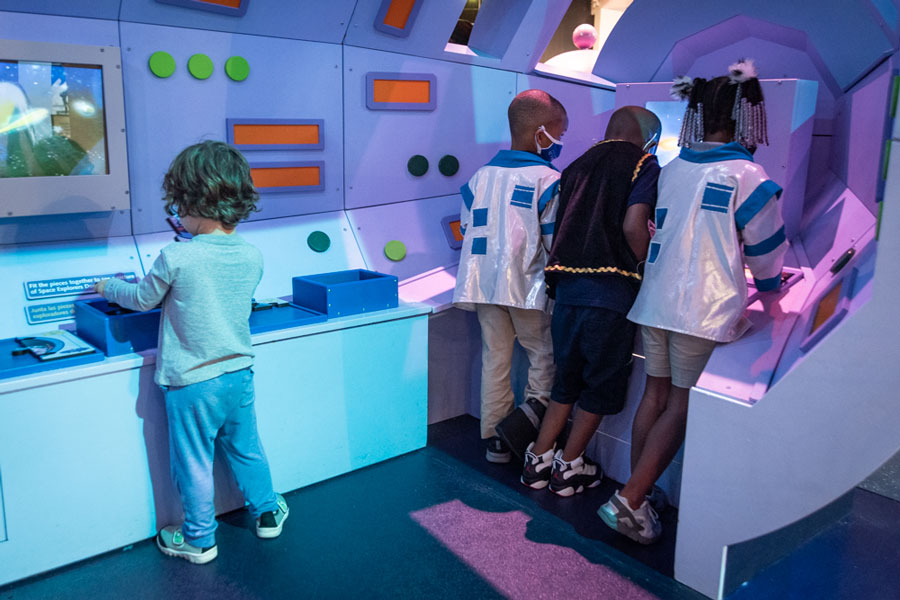 MODS members and students from Jack & Jill Children's Center enjoying the rocket ship.