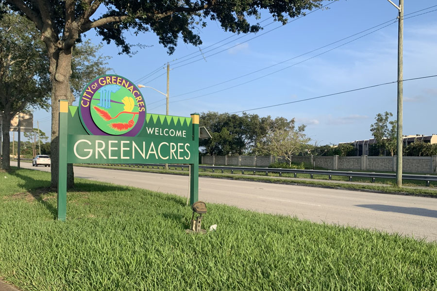 A sign welcomes drivers to the City of Greenacres in Palm Beach County.