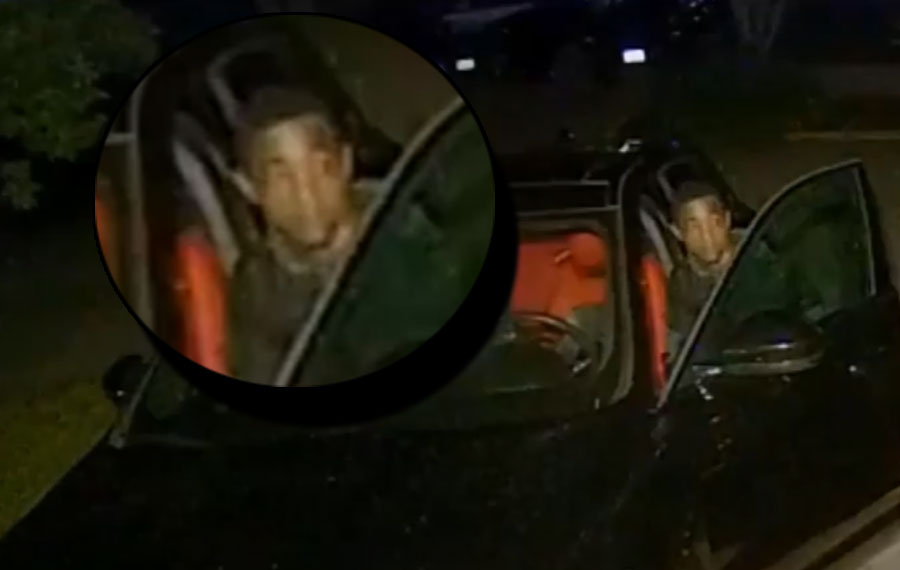 The video shows a young male wearing a dark colored jacket and light colored shorts walking onto the homeowner's property.